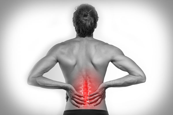 black and white photo of woman with back pain highlighted in red