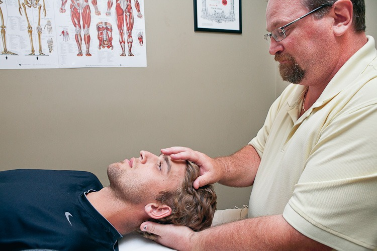 Craniosacral Therapy being preformed on a patient